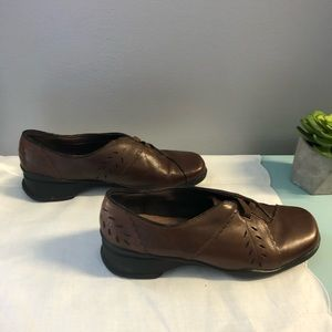 Clark's slip on brown shoes